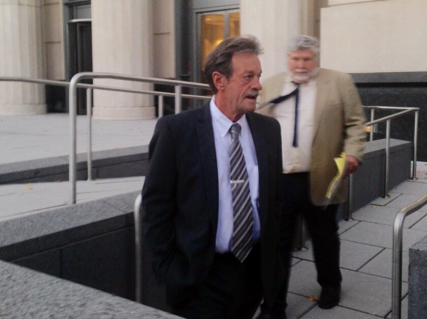 Witness William Ross, center, leaves U.S. District Court with his attorney, Wednesday, Nov. 4, 2015 in Charleston, W.Va.,  after testifying in the trial of former Massey Energy CEO Don Blankenship. Ross is one of the government's top witnesses and is a former Massey Energy safety official. Blankens