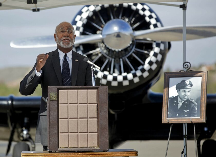 Reginald Owens addresses the audience Saturday at the dedication of the Oceanside airport in memory of the late Bob Maxwell, a former Tuskegee Airman who helped save airport when some city officials wanted to close it.
