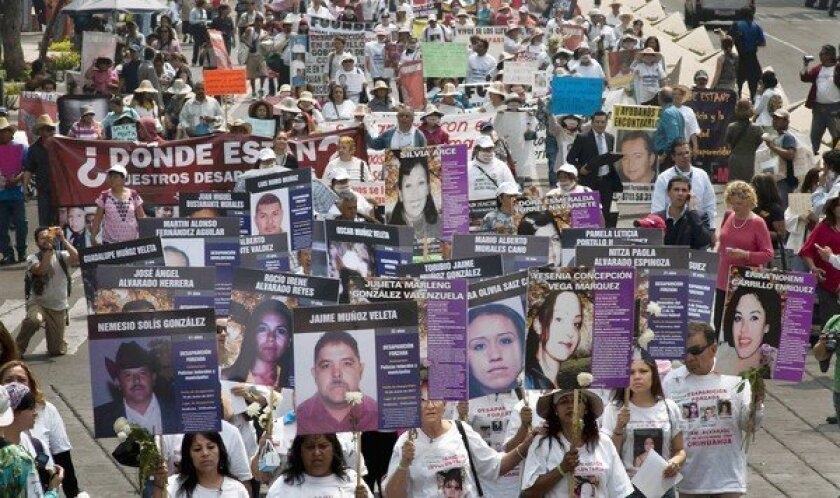 Hundreds of people demonstrate in May against drug violence -- specifically, forced disappearances -- in Mexico City. The violence is a major campaign issue in the upcoming presidential election.