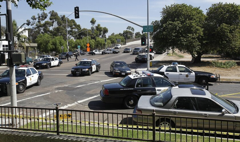An officer-involved shooting in Logan Heights involved a CHP officer and a motorist, sending the motorist to the hospital and creating a police scene at the Oceanview Boulevard exit of southbound Interstate 15 for several hours.