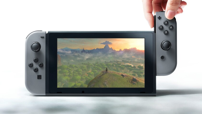 "The Nintendo Switch, in handheld mode, running ""The Legend of Zelda: Breath of the Wild."""