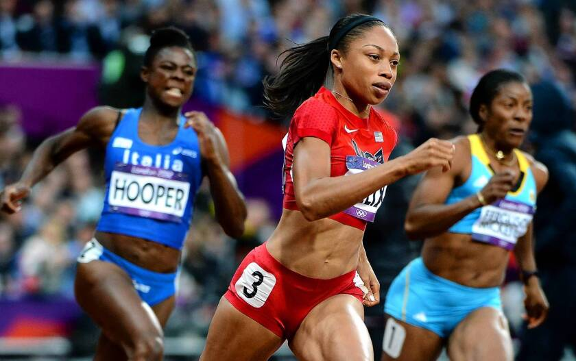 Southern California's Allyson Felix, center, pulls ahead to win her heat in the 200 meters at the 2012 London Olympics. She went on to capture the gold medal, which will reap her a $25,000 honorarium from the U.S. Olympic Committee.