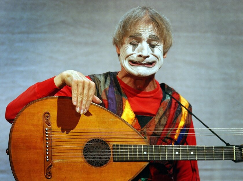 FILE ---  In this Nov. 20, 2003 file picture , Clown Dimitri  performs in  in Zurich, Switzerland. The well-known Swiss entertainer died at the age of 80 as his family confirmed Wednesday,  July 20,  2016. Dimitri was a popular clown and mime. (Eddy Risch/Keystone via AP)