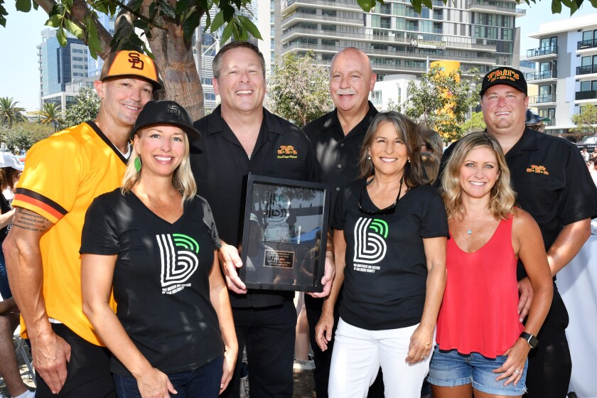 Jeff and Tina Rose (she's BBBS-SD operations VP), Jeff Loya (Phil's BBQ CFO), Phil Pace (Phil's BBQ CEO; event founder), Lorie Zapf (BBBS-SD president/CEO), Kevin and Michelle Sheehan (he's Phil's BBQ COO; 2019 BBBS-SD Volunteer of the Year awardee)