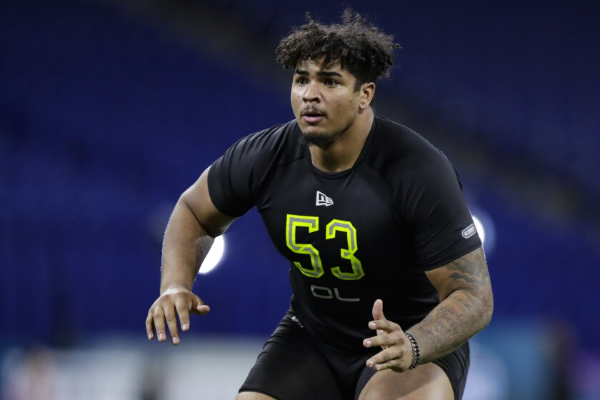 Iowa offensive lineman Tristan Wirfs runs a drill at the NFL football scouting combine in Indianapolis