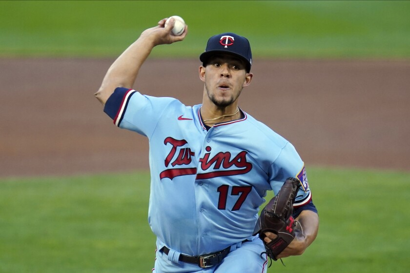 Minnesota Twins pitcher Jose Berrios throws to a Chicago White Sox batter during the first inning of a baseball game Wednesday, Sept. 2, 2020, in Minneapolis. (AP Photo/Jim Mone)