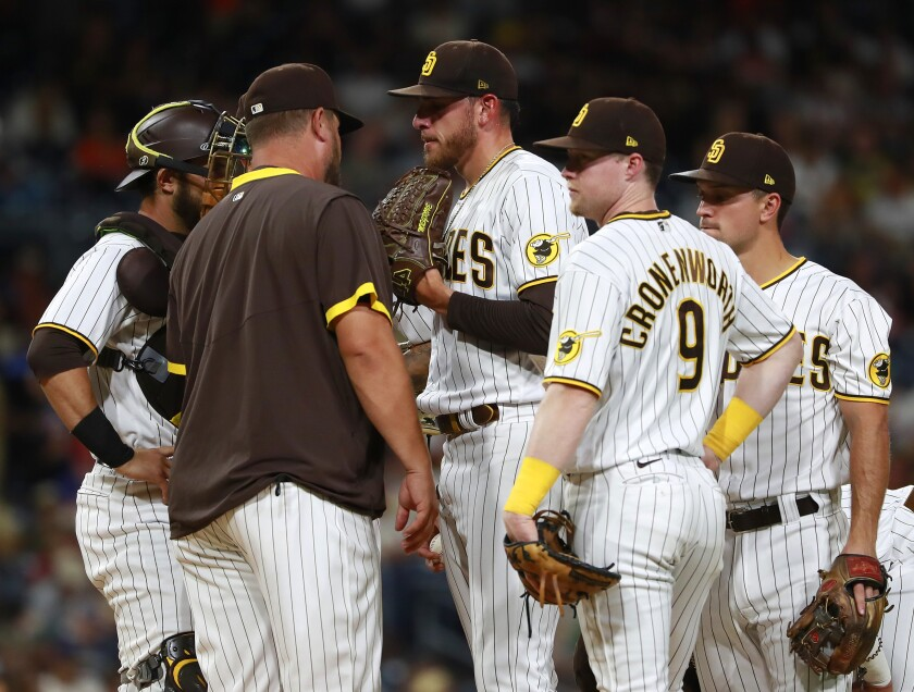 Padres starter Joe Musgrove talks to pitching coach Ben Fritz in the series opener with the Giants on Tuesday at Petco Park.
