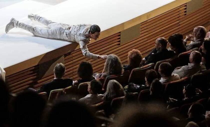"""In the guise of an antic Leporello, Kevin Burdette engages the audience during a performance of the L.A. Phil's """"Don Giovanni."""""""