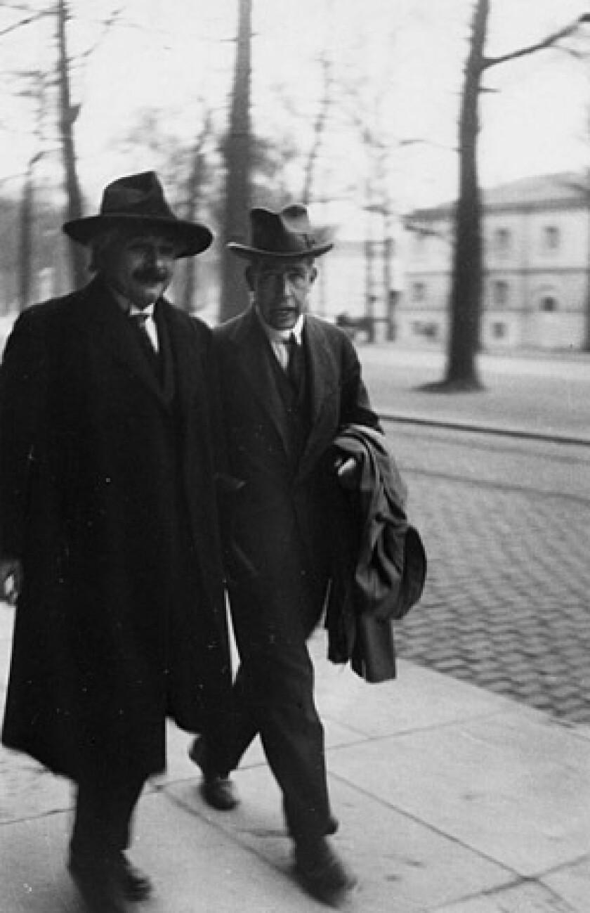 Albert Einstein, left, with Niels Bohr in 1930.