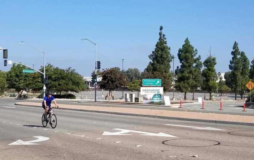 A cyclist cruises by Grossmont College earlier this fall. The school is hosting an online career expo on Oct. 28.