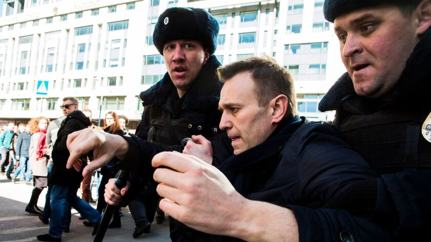 This handout picture taken and provided by Evgeny Feldman for Alexei Navalny's campaign on March 26, 2017, shows police officers detaining Navalny during an unauthorized anti-corruption rally in central Moscow. (Handout / AFP/Getty Images)