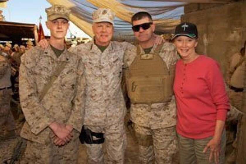 From left, Lance Cpl. Cookie Haynes, Commandant James Amos, Master Sgt. David Peacock and Bonnie Amos in Musa Qal'eh, Afghanistan in December 2012. U.S. Marine Corps photos by Sgt. Mallory S. Vanderschans