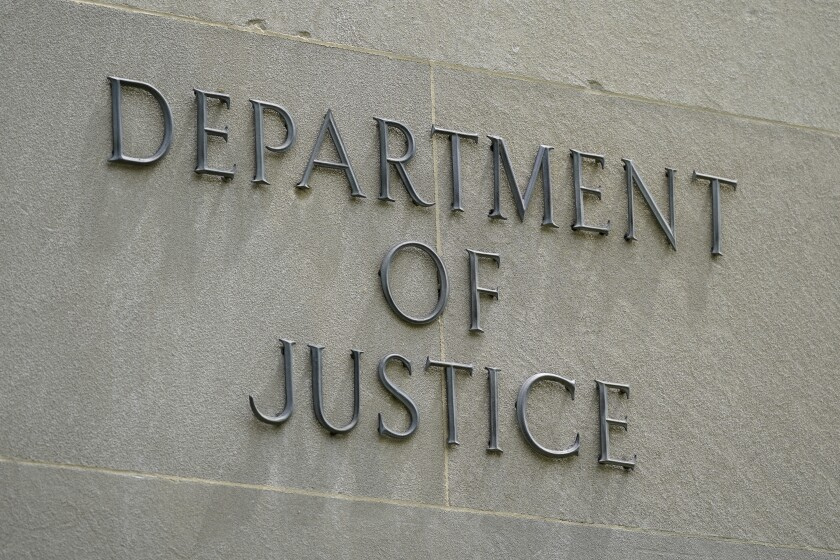 """""""Department of Justice"""" sign on its headquarters in Washington."""