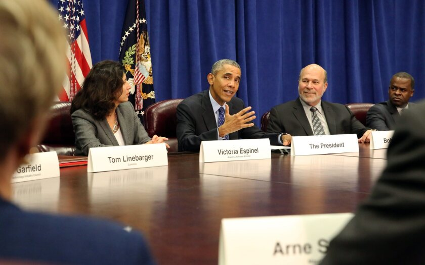 President Barack Obama meets with agriculture and business leaders to discuss the Trans-Pacific Partnership at the Department of Agriculture in Washington on Oct. 6.