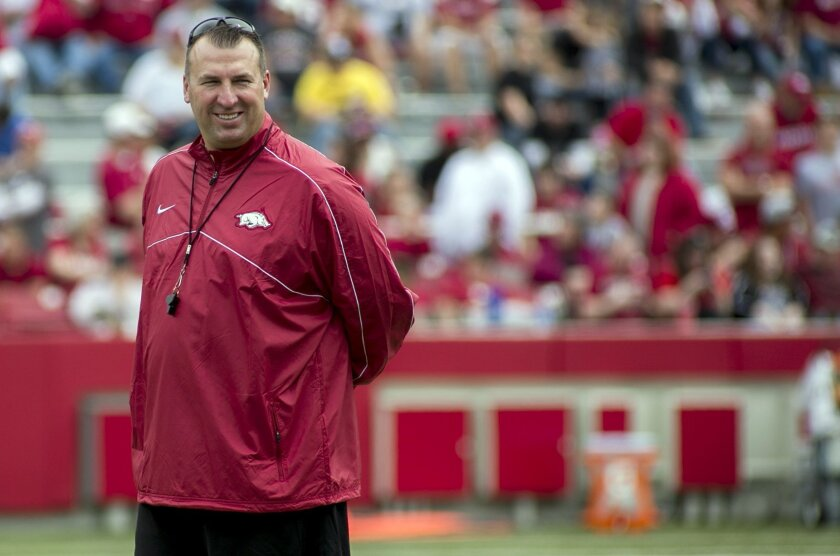 FILE - In this April 20, 2013, file photo, Arkansas head coach Bret Bielema watches his team warm up before of a spring NCAA college football game in Fayetteville, Ark. Bielema felt much more at ease at Arkansas in his second spring with the program. With the spring completed, the Razorbacks coach