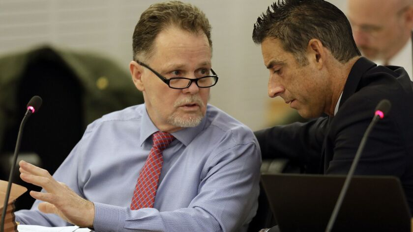 """Charles """"Chase"""" Merritt, left, pictured here on the first day of his murder trial, is accused of killing the McStay family in 2010 and burying their bodies in the desert in Victorville."""