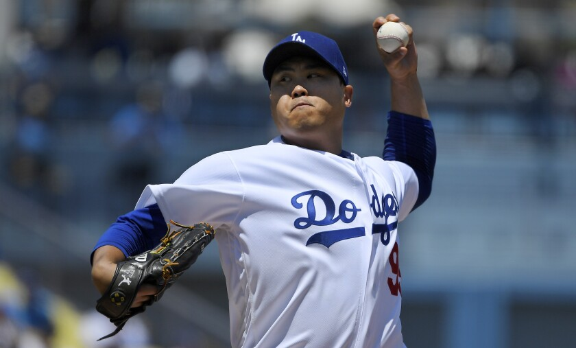 Dodgers starter Hyun-Jin Ryu delivers during first inning of 9-3 victory over the Arizona Diamondbacks on Sunday.