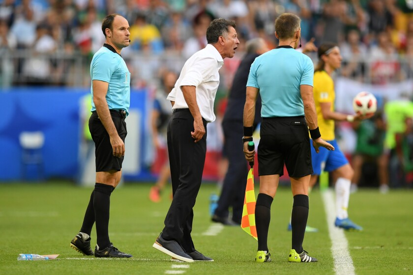 Juan Carlos Osorio, Manager of Mexico complains to fourth official during the 2018 FIFA World Cup Russia Round of 16 match between Brazil and Mexico at Samara Arena on July 2, 2018 in Samara, Russia.