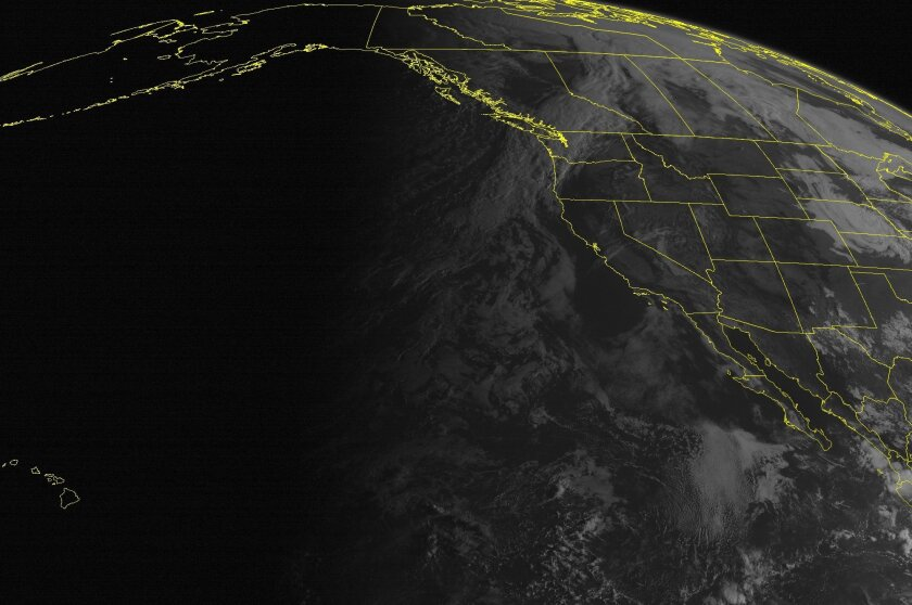 This satellite image from the National Oceanic and Atmospheric Administration taken Friday shows mostly fair weather across much of the western United States. However, triple-digit temperatures are forecast for Southern California this weekend.
