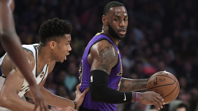 Lakers' LeBron James, right, tries to get past Milwaukee's Giannis Antetokounmpo during a March 1 game at Staples Center.