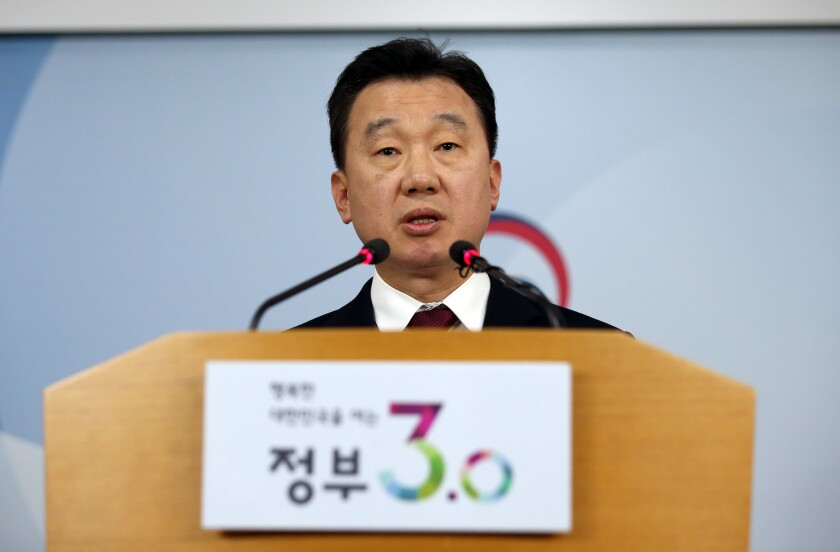 South Korean Unification Ministry spokesman Jeong Joon Hee speaks about the defection of North Korean workers to South Korea during a briefing at the government complex in Seoul on April 8, 2016.