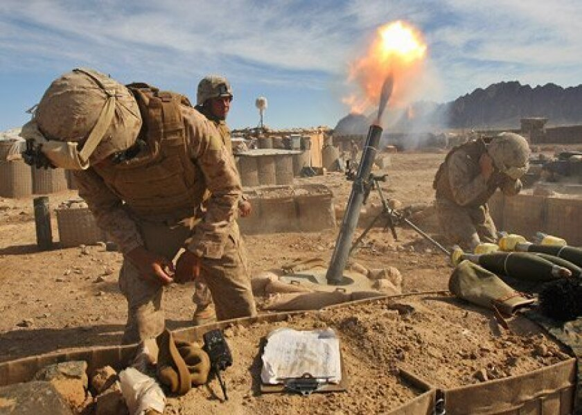 U.S. Marines fire mortars on Taliban positions in 2009 in Afghanistan's Helmand province. (John Moore / Getty Images)