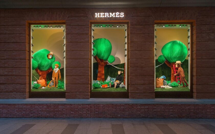 The summer-season window with monkeys, designed by Don Porcella, at the Hermès store in Shanghai, China