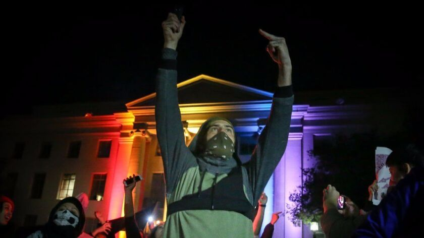Protesters demonstrate Wednesday night in Berkeley in opposition to a speech by controversial Breitbart writer Milo Yiannopoulos. The event was canceled after protests turned violent.