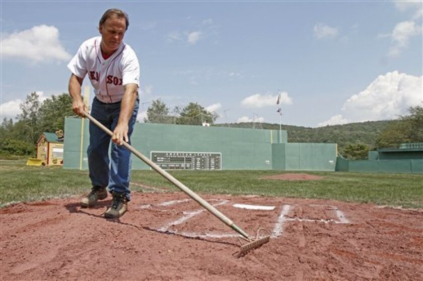 Pat O'Connor rakes around home plate at Little Fenway, a scaled-down version of the major league field in Essex, Vt., Monday, Aug. 2, 2010. Little Fenway is a unique 1/4th scale replica of Boston's Fenway Park in the backyard of Pat & Beth O'Connor's house in Essex, Vermont. It was built in 2001 an