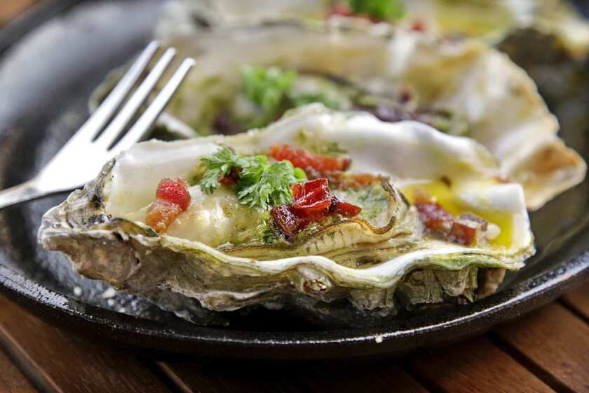 Casino oysters with butter, paprika, thyme, shallots and neuske's bacon, served at L&E Oyster Bar, on Silver Lake Blvd.