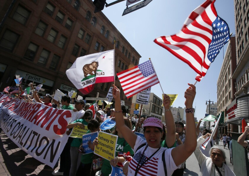 Hundreds march downtown in support of immigration reform