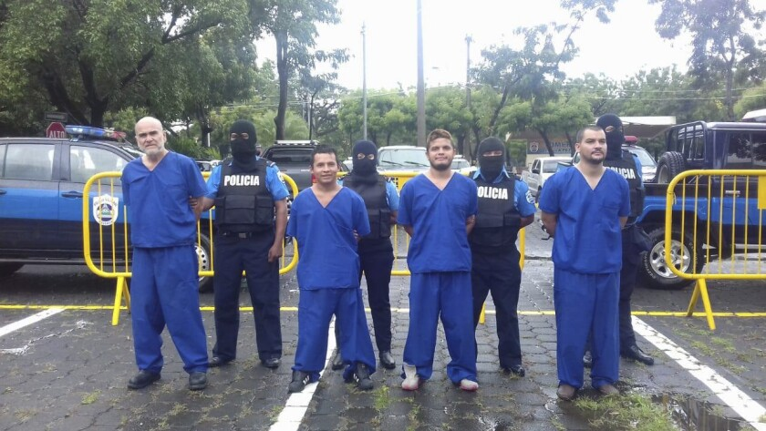 Nicaraguan American Eddy Montes Praslin, far left, is among the prisoners displayed before the news media after a prison disturbance in October 2018.