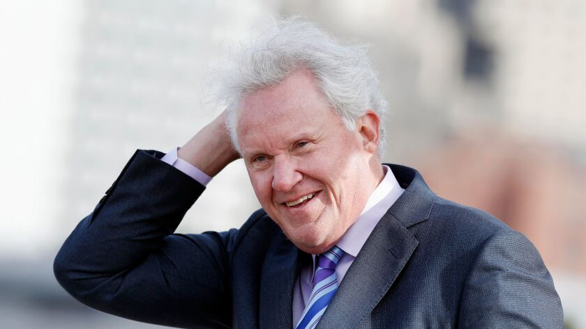 Why is this man laughing? Departing General Electric CEO Jeff Immelt braves the weather at a groundbreaking ceremony for GE's new Boston headquarters last month.