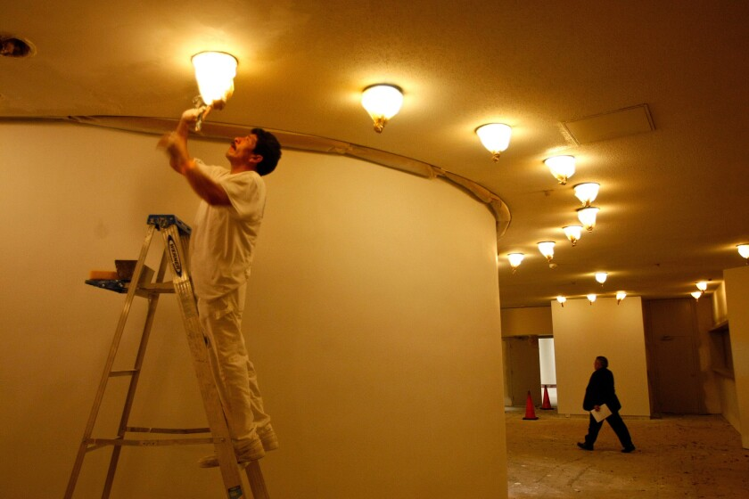 Jose Luis works on drywall inside the foyer of the Pasadena Ballroom of the Westin Bonaventure Hotel in downtown Los Angeles in 2010. Hotels across the country are expected to spend a record $6 billion on upgrades in 2014.