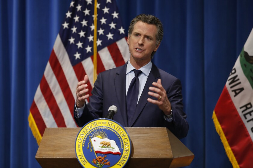 Gov. Gavin Newsom discusses his revised 2020-2021 state budget during a news conference in Sacramento.
