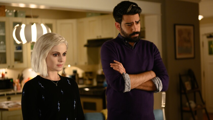 """Rose McIver and Rahul Kohli in a new episode of the lighthearted pre-apocalypse drama """"iZombie"""" on CW."""