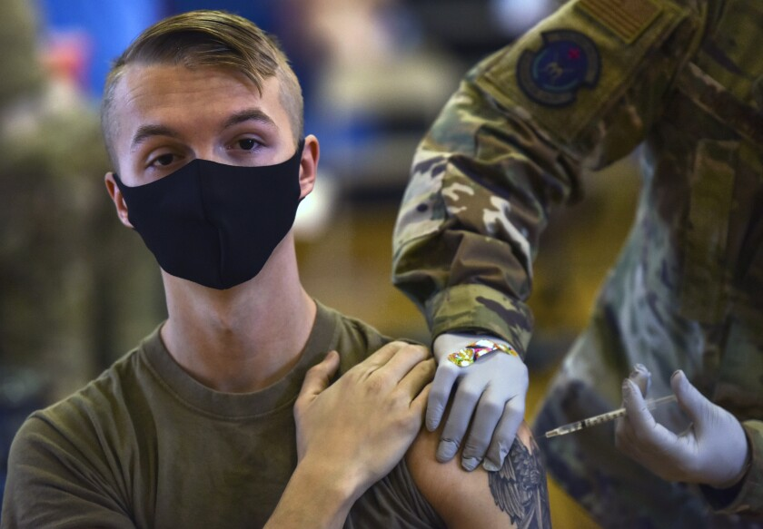 A U.S. serviceman receives a vaccination at Joint Base Pearl Harbor-Hickam in 2021