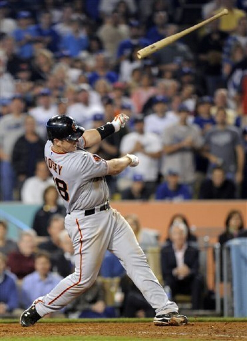 San Francisco Giants' Buster Posey lets go of his bat as he strikes out during the seventh inning of their Major League Baseball game against the San Francisco Giants, Friday, April 1, 2011, in Los Angeles. A fan was struck in the head by the bat. (AP Photo/Mark J. Terrill)