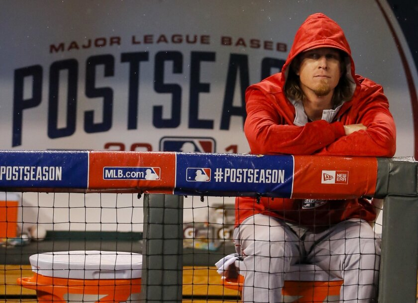 Los Angeles Angels pitcher Jered Weaver (36) sits in the rain following Game 3 of baseball's AL Division Series in Kansas City, Mo., Sunday, Oct. 5, 2014. The Kansas City Royals defeated the Los Angeles Angels 8-3 to sweep the series. (AP Photo/Travis Heying)