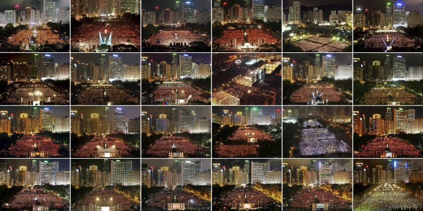 This combination of images taken between 1997 and 2020 shows the thousands of people who attended the June 4th candlelight vigil in Hong Kong's Victoria Park to mark the anniversary of the 1989 military crackdown on a pro-democracy student movement in Beijing. Hong Kong has been one of just two cities in China allowed to mark the bloody crackdown on pro-democracy protesters in Beijing's Tiananmen Square in 1989. Top row from left; 1997, 1998, 1999, 2000, 2001 and 2002. Second row from left; 2003, 2004, 2005, 2006, 2007 and 2008. Third row from left; 2009, 2010, 2011, 2012, 2013 and 2014. Bottom row from left; 2015, 2016, 2017, 2018, 2019 and 2020. (AP Photo/Vincent Yu)