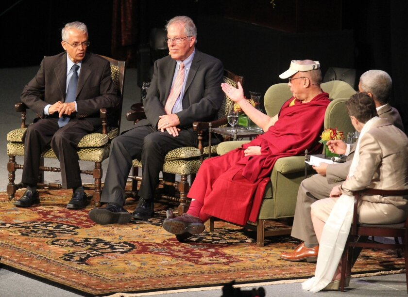 His Holiness the Dalai Lama discusses the global impact of climate change with researchers Veerabhadran Ramanathan. left, and Richard C.J. Somerville at UCSDs RIMAC Arena.
