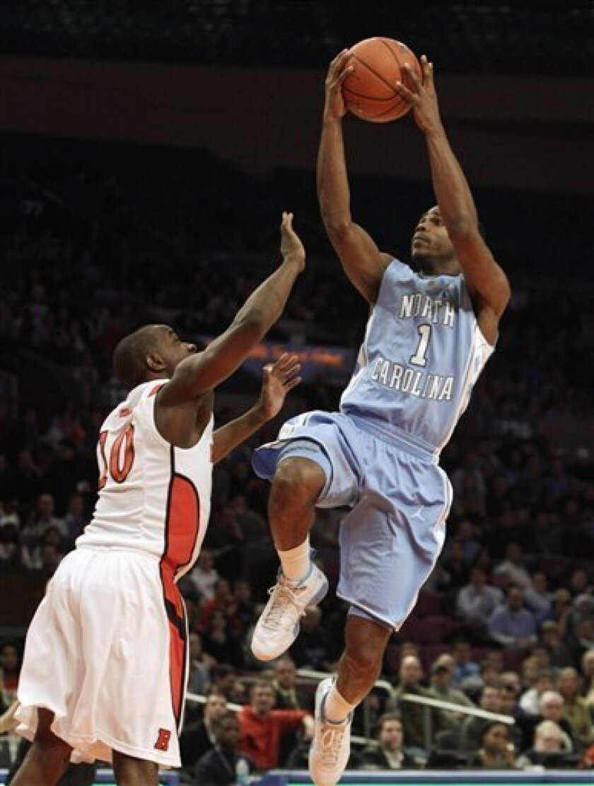 North Carolina guard Dexter Strickland (1) goes up for a layup as Rutgers' James Beatty (10) defends in the first half of an NCAA college basketball game at Madison Square Garden in New York, Tuesday, Dec. 28, 2010. (AP Photo/Kathy Willens)