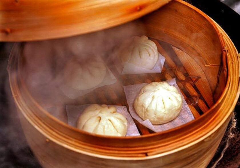 Freshly steamed homemade <i>bao</i>, filled with fragrant roast pork or chicken, has a slightly chewy, flavorful dough.