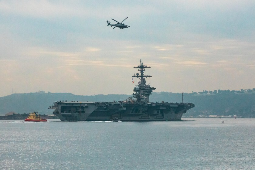 The USS Theodore Roosevelt left San Diego Harbor for deployment on Monday.