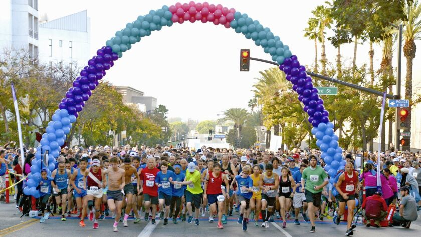 The Burbank Community YMCA's 9th Annual Turkey Trot hit a new record with more than 3,000 runners pa