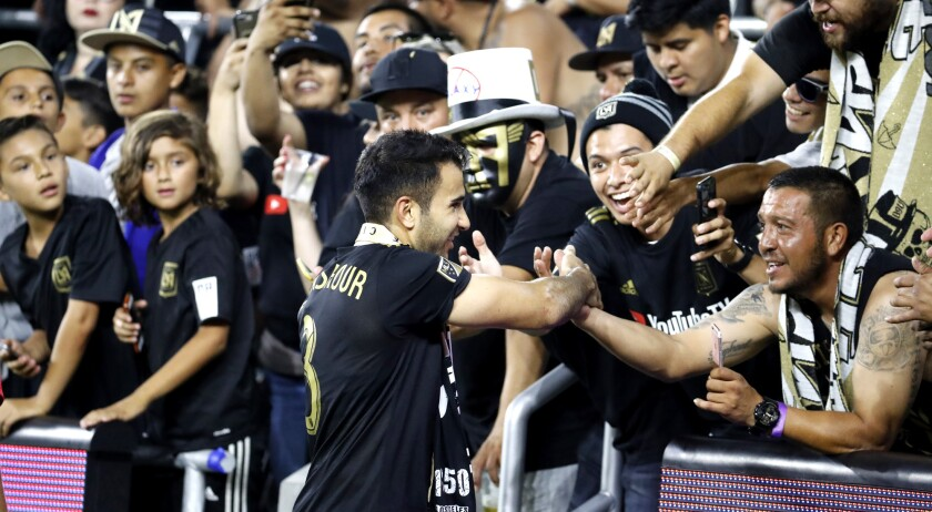 LAFC defender Steven Beitashour greets fans at Banc of California Stadium during the team's inaugural season.
