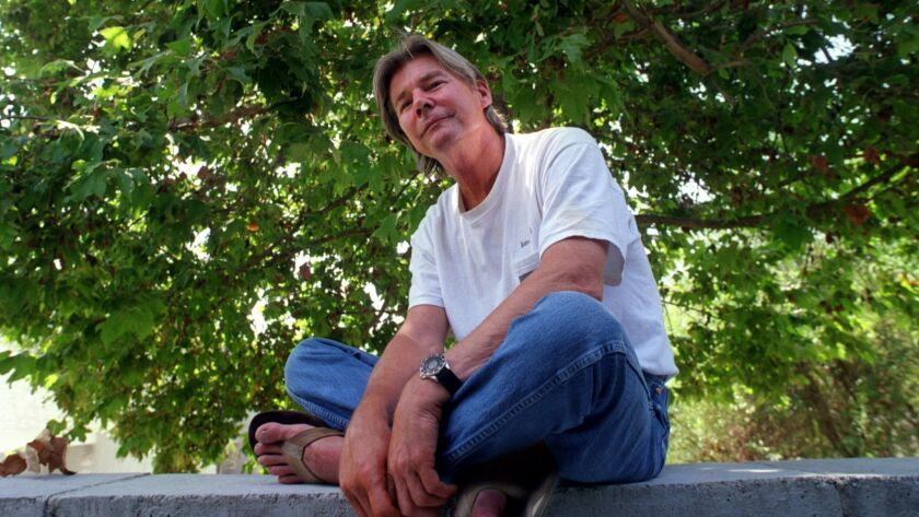 CA.Vincent.tree.0725.AAG––Actor Jan–Michael Vincent sits in the backyard of his Coto de Caza home as