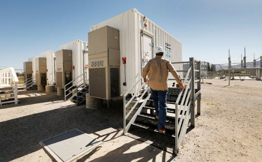 San Diego Gas & Electric engineer Steven Prsha approaches one of several shipping containers packed with lithium-ion batteries at SDG&E's Borrego Springs microgrid.