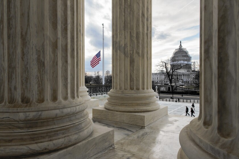 The flag flies at half-staff at the Supreme Court for Justice Antonin Scalia