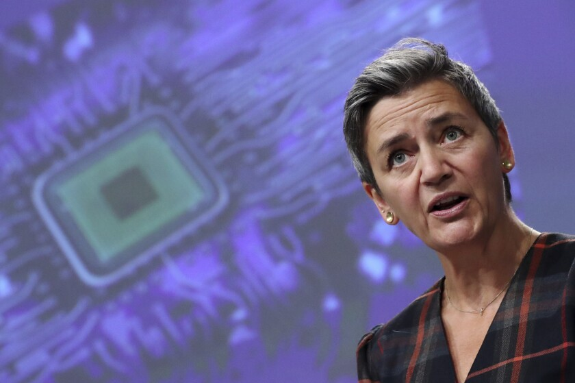 FILE - In this Wednesday, Oct. 7, 2020 file photo, European Commissioner for Europe fit for the Digital Age Margrethe Vestager speaks during an online news conference at the European Commission headquarters in Brussels. The European Union is set to propose new laws to rein in the power of big tech companies, including measures to ensure customers are protected, smaller rivals are treated fairly, and illegal content is dealt with, the bloc's digital and antitrust chief said on Thursday, Oct, 29. Executive Vice President Margrethe Vestager outlined two draft laws that the EU's executive Commission plans to introduce in early December. (Yves Herman/Pool Photo via AP, file)
